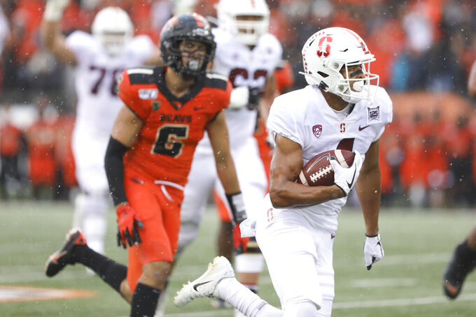 CORRECTS TO SATURDAY NOT FRIDAY  - Stanford wide receiver Michael Wilson, foreground, scores a touchdown off a pass from quarterback Davis Mills during the first half of an NCAA college football game against Oregon State in Corvallis, Ore., Saturday, Sept. 28, 2019. (AP Photo/Amanda Loman)