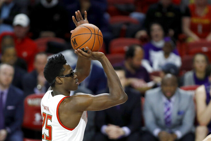 Maryland forward Jalen Smith shoots a free throw against Northwestern during the first half of an NCAA college basketball game, Tuesday, Feb. 18, 2020, in College Park, Md. (AP Photo/Julio Cortez)