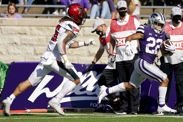 Kansas State running back Deuce Vaughn (22) beats Texas Tech defensive back Thomas Leggett (16) into the end zone to score a touchdown during the first half of an NCAA college football game Saturday, Oct. 3, 2020, in Manhattan, Kan. (AP Photo/Charlie Riedel)