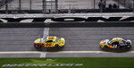 Joey Logano (22) beats Clint Bowyer (14) to the finish line to win the second NASCAR Daytona 500 qualifying auto race Thursday, Feb. 14, 2019, at Daytona International Speedway in Daytona Beach, Fla. (AP Photo/Chris O'Meara)