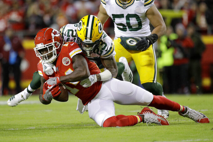 Kansas City Chiefs wide receiver Sammy Watkins (14) is tackled by Green Bay Packers cornerback Jaire Alexander (23) during the first half of an NFL football game in Kansas City, Mo., Sunday, Oct. 27, 2019. (AP Photo/Charlie Riedel)