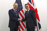 Acting US Defence Secretary Patrick Shanahan, left, shakes hands for the media with Britain's Defence Minister Gavin Williamson, before their bilateral meeting during a NATO defence ministers meeting at NATO headquarters in Brussels, Wednesday, Feb. 13, 2019. (AP Photo/Francisco Seco)