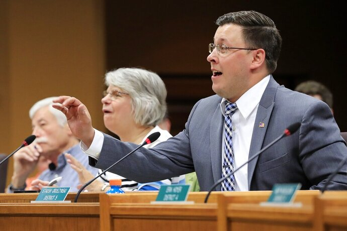 FILE - In this May 17, 2017 photo, Brown County Supervisor Staush Gruszynski speaks at a Brown County Board of Supervisors meeting at City Hall in Green Bay, Wis. Now a Wisconsin state Rep.,  Grusznyski, in December, was removed from committee assignments and the Democratic caucus after an investigation determined he