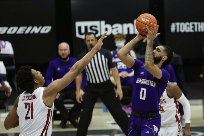 Washington guard Marcus Tsohonis (0) shoots over Washington State center Dishon Jackson (21) during the second half of an NCAA college basketball game in Pullman, Wash., Monday, Feb. 15, 2021.  (AP Photo/Young Kwak)