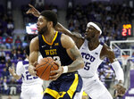 West Virginia forward Esa Ahmad (23) drives to the basket after getting past TCU forward JD Miller (15) in the first half of an NCAA college basketball game, Tuesday, Jan. 15, 2019, in Fort Worth, Texas. (AP Photo/Tony Gutierrez)