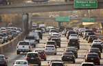 FILE - In this Dec. 12, 2018, file photo, traffic moves along the Hollywood Freeway in Los Angeles. At a board meeting Tuesday, Dec. 1, 2020, the Alliance for Automotive Innovation, a big industry trade association, recognized that change is coming. Alliance CEO John Bozzella said automakers are committed to working with the Biden administration, which will renew the fight against climate change and likely will undo pollution and gas mileage rollbacks made by President Donald Trump. (AP Photo/Damian Dovarganes, File)