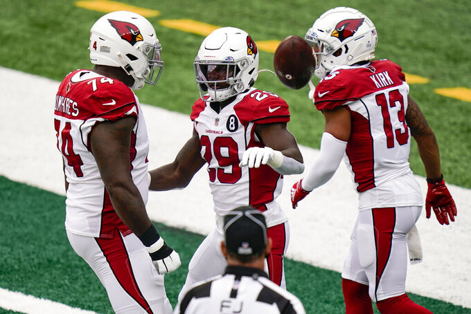 Arizona Cardinals running back Chase Edmonds (29) celebrates with his teammates after running in a touchdown during the first half of an NFL football game against the New York Jets, Sunday, Oct. 11, 2020, in East Rutherford. (AP Photo/Seth Wenig)