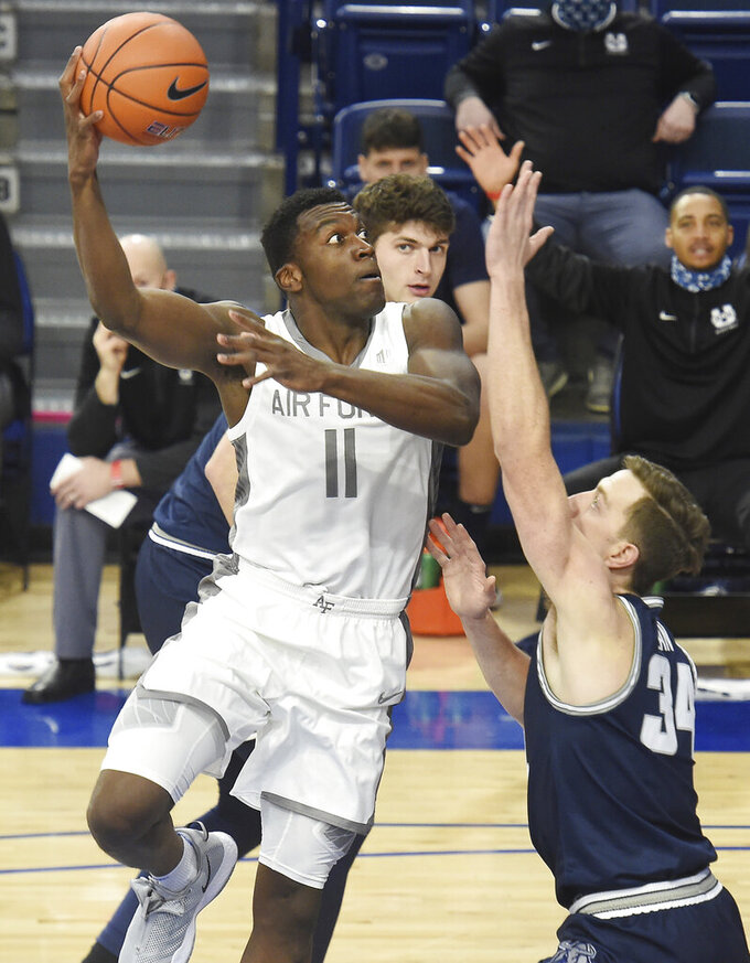 Air Force's Ameka Akaya shoots over Utah State's Justin Bean during the first half of an NCAA college basketball game Thursday, Dec. 31, 2020, at Air Force Academy, Colo. (Jerilee Bennett/The Gazette via AP)
