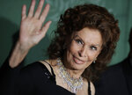 Actress Sophia Loren poses for photographers upon arrival at the Green Carpet Fashion Awards in Milan, Italy, Sunday, Sept. 22, 2019. (AP Photo/Luca Bruno)