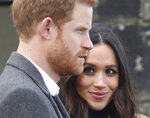 Britain's Prince Harry and his fiancee  Meghan Markle  during their visit at Edinburgh Castle, during their visit to Edinburgh Tuesday Feb. 13, 2018.(Jane Barlow/ Pool via AP)
