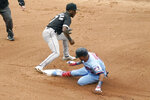 Minnesota Twins' Luis Arraez, right, beats the throw to Chicago White Sox shortstop Tim Anderson for a double in the first inning of a baseball game Wednesday, July 7, 2021, in Minneapolis. (AP Photo/Jim Mone)