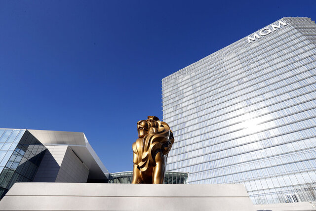 FILE - In this Dec. 2, 2016, file photo, the MGM lion stands in front of the 23-story hotel during a preview tour of the MGM National Harbor hotel and casino in Oxon Hill, Md. Maryland voters are deciding two statewide ballot questions with significant financial ramifications for future years, including whether to allow sports betting and if the legislature should have more power over the state budget. Details such as where sports betting would be allowed will be decided later.  (AP Photo/Alex Brandon, File)