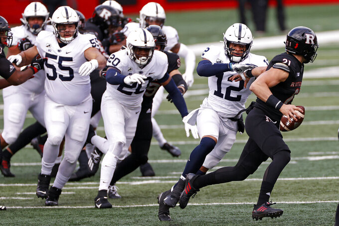 Penn State linebacker Brandon Smith (12) tackles Rutgers quarterback Johnny Langan (21) during the first half of an NCAA college football game Saturday, Dec. 5, 2020, in Piscataway, N.J. (AP Photo/Adam Hunger)