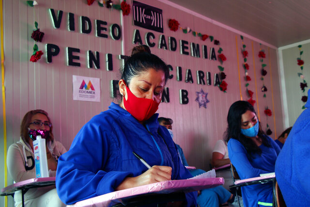 Women prisoners attend an online course on writing at the Santiaguito prison in Almoloya de Juarez, Mexico, Friday, Aug. 28, 2020, amid the new coronavirus pandemic. The inmates at the prison west of Mexico City have managed to benefit from pandemic lockdowns because the lockdowns have spurred a wave of professionals with time on their hands willing to donate their time giving online classes to inmates. (AP Photo/Diego Delgaldo)