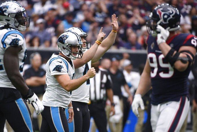 Carolina Panthers punter Michael Palardy (5) and kicker Joey Slye (4) celebrates a field goal against the Houston Texans during the first half of an NFL football game Sunday, Sept. 29, 2019, in Houston. (AP Photo/Eric Christian Smith)