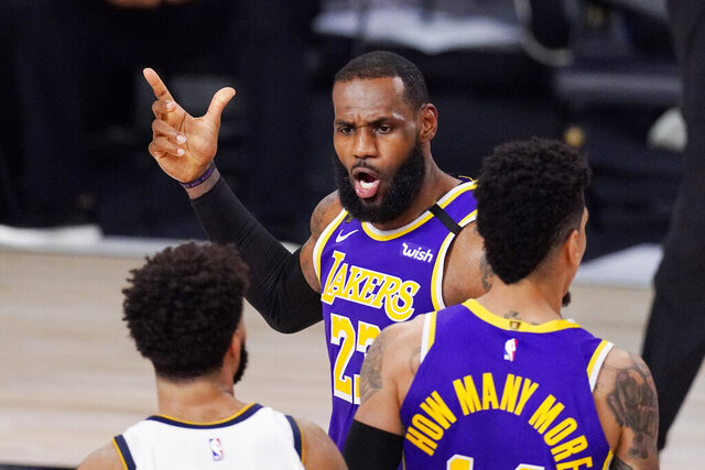 Los Angeles Lakers' LeBron James (23) voices his opinion after a play in the second half of an NBA conference final playoff basketball game against the Denver Nuggets Saturday, Sept. 26, 2020, in Lake Buena Vista, Fla. (AP Photo/Mark J. Terrill)