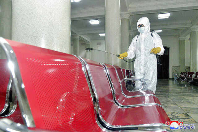 In this undated photo provided on Saturday, Aug. 29, 2020, by the North Korean government, an employee disinfects the inside of Pyongyang Station to protect against the coronavirus in Pyongyang, North Korea. Independent journalists were not given access to cover the event depicted in this image distributed by the North Korean government. The content of this image is as provided and cannot be independently verified. Korean language watermark on image as provided by source reads: