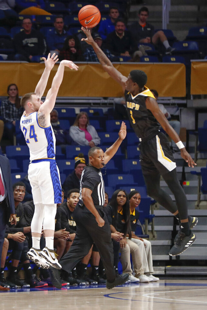 Pittsburgh's Ryan Murphy (24) shoots over Arkansas-Pine Bluff's Markedric Bell (3) during the first half of an NCAA college basketball game Thursday, Nov. 21, 2019, in Pittsburgh. (AP Photo/Keith Srakocic)