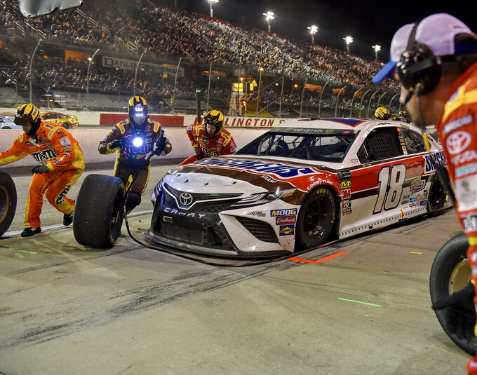 Kyle Busch comes in for a pit stop during a NASCAR Cup Series auto race on Sunday, Sept. 1, 2019, at Darlington Raceway in Darlington, S.C. (AP Photo/Richard Shiro)
