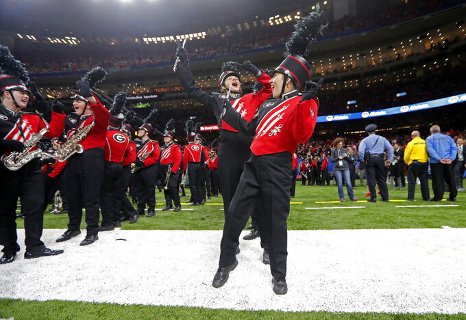 Members of the Georgia band dance and sing before the team's Sugar Bowl NCAA college football game against Texas in New Orleans, Tuesday, Jan. 1, 2019. (AP Photo/Gerald Herbert)