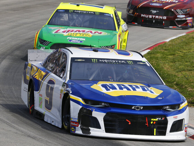 Monster Energy NASCAR Cup Series driver Chase Elliott (9) leads Ryan Blaney (12) into turn four during the NASCAR Cup Series auto race at the Martinsville Speedway in Martinsville, Va., Sunday, March 24, 2019. (AP Photo/Steve Helber)