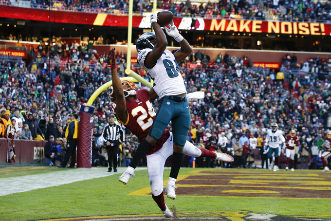 Philadelphia Eagles wide receiver Greg Ward (84) catches a touchdown pass beating out Washington Redskins cornerback Josh Norman (24) in the second half of an NFL football game, Sunday, Dec. 15, 2019, in Landover, Md. Eagles won 37-27. (AP Photo/Alex Brandon)