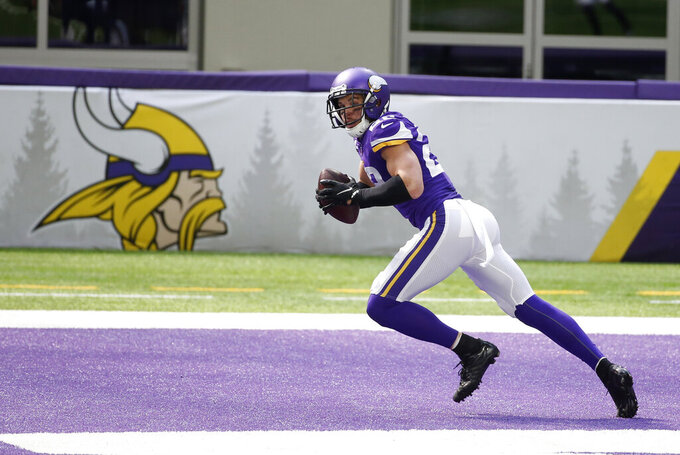 Minnesota Vikings strong safety Harrison Smith intercepts a pass in the end zone during the first half of an NFL football game against the Tennessee Titans, Sunday, Sept. 27, 2020, in Minneapolis. (AP Photo/Bruce Kluckhohn)