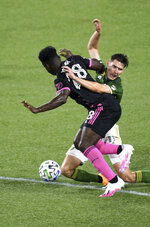 Seattle Sounders defender Yeimar Gomez, left and Portland Timbers forward Jaroslaw Niezgoda compete for the ball during the first half of an MLS soccer match in Portland, Ore., Wednesday, Sept. 23, 2020. (AP Photo/Steve Dykes)