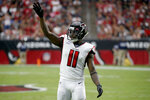Atlanta Falcons wide receiver Julio Jones (11) motions during the first half of an NFL football game against the Arizona Cardinals, Sunday, Oct. 13, 2019, in Glendale, Ariz. (AP Photo/Ross D. Franklin)