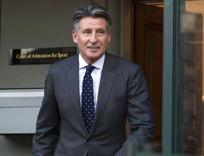 FILE - In this Monday, Feb. 18, 2019, file photo, Sebastian Coe leaves the Court of Arbitration for Sport in Lausanne, Switzerland. The date of the next world track championships is in limbo until the International Olympic Committee decides on a new schedule for the postponed Tokyo Games. Coe, the Olympic great who is now president of World Athletics, said Friday, March 27, 2020, there are plenty of options for rescheduling next year's world championships in Eugene, Oregon, but at the moment they all depend on the IOC. (Laurent Gillieron/Keystone via AP, File)