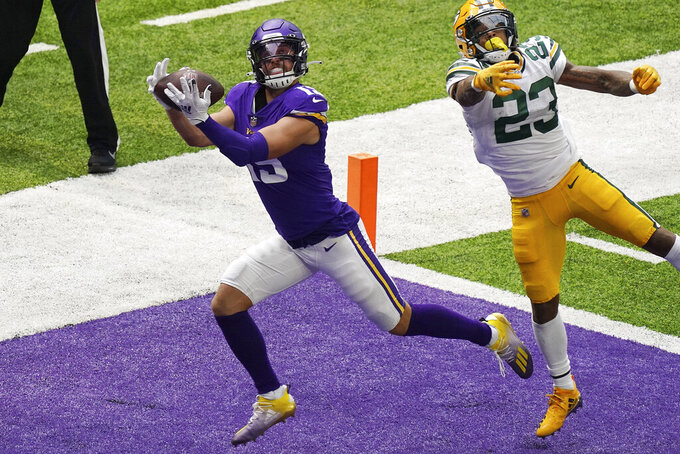 Minnesota Vikings wide receiver Adam Thielen (19) hauled in a touchdown pass as Green Bay Packers cornerback Jaire Alexander (23) tries to defend in the second half of an NFL football game Sunday, Sept. 13, 2020, in Minneapolis, Minn.  (Anthony Souffle/Star Tribune via AP)