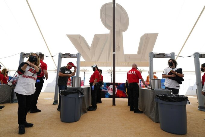 Fans arrive before the NFL Super Bowl 55 football game between the Kansas City Chiefs and Tampa Bay Buccaneers, Sunday, Feb. 7, 2021, in Tampa, Fla. (AP Photo/Ashley Landis)
