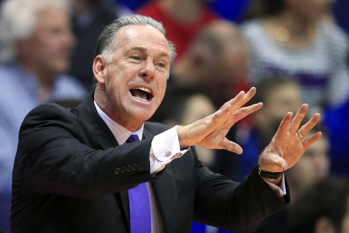 TCU coach Jamie Dixon directs the team during the first half of an NCAA college basketball game against Kansas in Lawrence, Kan., Wednesday, March 4, 2020. (AP Photo/Orlin Wagner)