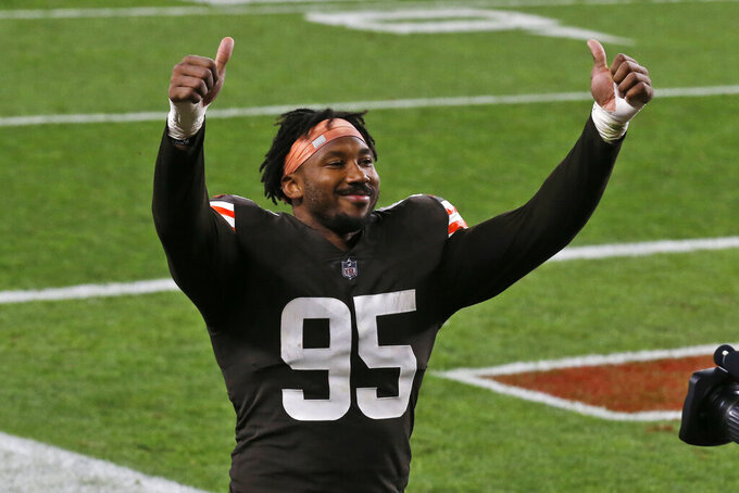 Cleveland Browns defensive end Myles Garrett celebrates after the Browns defeated the Cincinnati Bengals 35-30 in an NFL football game Thursday, Sept. 17, 2020, in Cleveland. (AP Photo/Ron Schwane)