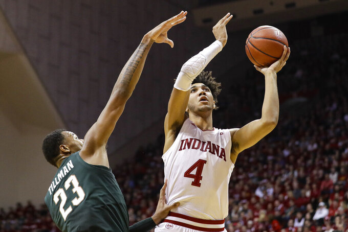 Indiana forward Trayce Jackson-Davis (4) shoots over Michigan State forward Xavier Tillman (23) in the first half of an NCAA college basketball game in Bloomington, Ind., Thursday, Jan. 23, 2020. (AP Photo/Darron Cummings)