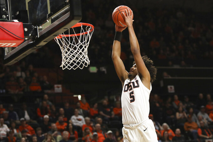 Oregon State's Ethan Thompson (5) dunks during the first half of an NCAA college basketball game against Southern California in Corvallis, Ore., Saturday, Jan. 25, 2020. (AP Photo/Amanda Loman)