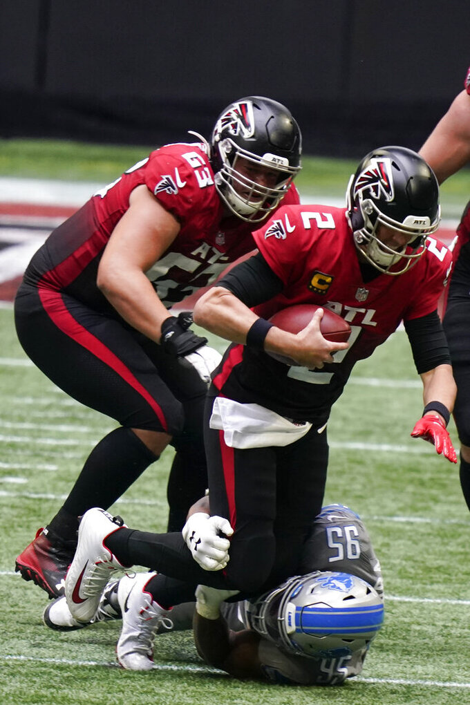 Detroit Lions defensive end Romeo Okwara (95) sacks Atlanta Falcons quarterback Matt Ryan (2) during the second half of an NFL football game, Sunday, Oct. 25, 2020, in Atlanta. (AP Photo/Brynn Anderson)