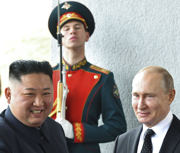 Russian President Vladimir Putin, right, and North Korea's leader Kim Jong Un pose for photographers during their meeting in Vladivostok, Russia, Thursday, April 25, 2019. President Putin opened his talks with Kim, saying that Russia would like to help support efforts to resolve the North Korean nuclear standoff. (Yuri Kadobnov/Pool Photo via AP)