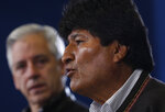 Bolivia's President Evo Morales speaks during a press conference at the military airport in El Alto, Bolivia, Saturday, Nov. 9, 2019. Police in three of the most important cities of Bolivia retreated to their barracks asking for the resignation of Morales who called for a dialogue with the opposition to pacify the country after weeks of protests against the results of the presidential elections. Pictured left is Vice President Alvaro Garcia Linera. (AP Photo/Juan Karita)