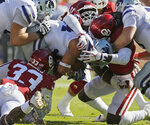 Kansas State running back Alex Barnes, center, is surrounded by Oklahoma defenders in the first half of an NCAA college football game in Norman, Okla., Saturday, Oct. 27, 2018. Barnes, who entered the game as the Big 12's leading rusher, was limited to 28 yards on 13 carries. (AP Photo/Sue Ogrocki)