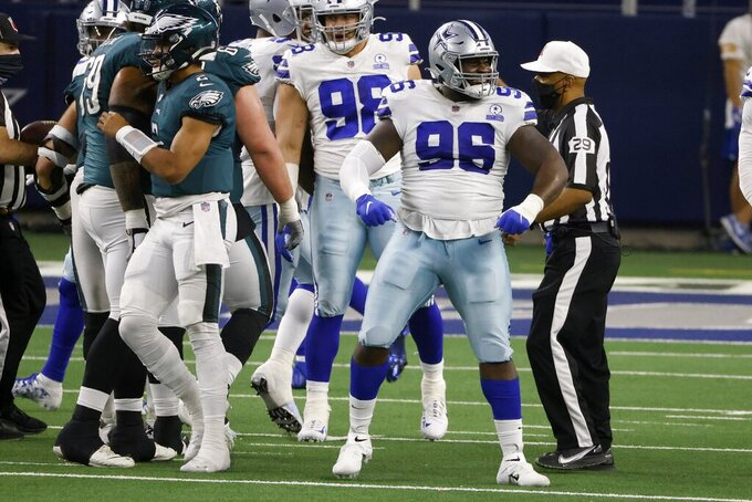Dallas Cowboys defensive tackle Neville Gallimore (96) celebrates after helping sack Philadelphia Eagles quarterback Jalen Hurts (2) in the second half of an NFL football game in Arlington, Texas, Sunday, Dec. 27. 2020. (AP Photo/Ron Jenkins)
