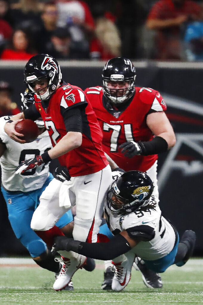 Atlanta Falcons quarterback Matt Ryan (2) is sacked by Jacksonville Jaguars defensive end Dawuane Smoot (94) during the second half of an NFL football game, Sunday, Dec. 22, 2019, in Atlanta. (AP Photo/John Bazemore)