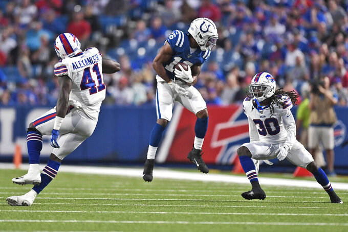Indianapolis Colts' Marcus Johnson, center, makes a catch during the first half of an NFL preseason football game against the Indianapolis Colts, Thursday, Aug. 8, 2019, in Orchard Park, N.Y. (AP Photo/Adrian Kraus)