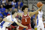 Oklahoma's Jalen Hill (1) and Creighton's Marcus Zegarowski (11) go after a loose ball during the first half of an NCAA college basketball game in Omaha, Neb., Tuesday, Dec. 17, 2019. (AP Photo/Nati Harnik)