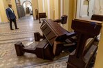 Sen. Tim Scott, R-S.C., stops to look at damage in the early morning hours of Thursday, Jan. 7, 2021, after protesters stormed the Capitol in Washington, on Wednesday. (AP Photo/Andrew Harnik)