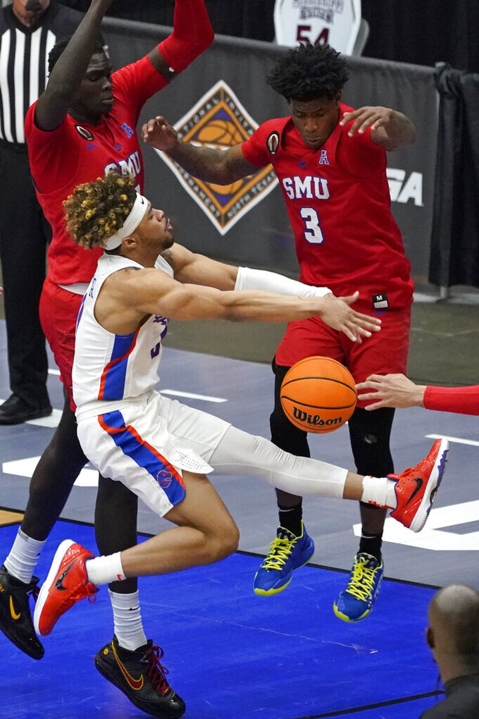 Boise State guard Marcus Shaver Jr. loses control of the ball in front of SMU guard Kendric Davis (3) during the second half of an NCAA college basketball game in the first round of the NIT, Thursday, March 18, 2021, in Frisco, Texas. (AP Photo/Tony Gutierrez)