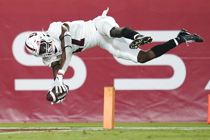 Stanford cornerback Kyu Blu Kelly lunges into the end zone to score after intercepting a Southern California pass during the second half of an NCAA college football game Saturday, Sept. 11, 2021, in Los Angeles. (AP Photo/Marcio Jose Sanchez)