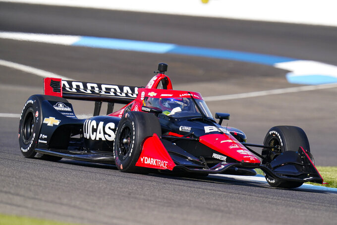 Juan Pablo Montoya of Colombia drives during practice for the IndyCar auto race at Indianapolis Motor Speedway in Indianapolis, Friday, May 14, 2021. (AP Photo/Michael Conroy)