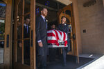 Pallbearers carry the remains of Army Sgt. 1st Class Elliott Robbins on Thursday, July 18, 2019, at St. James Catholic Church in Ogden, Utah. Robbins died in a non-combat incident on June 30 while serving in Afghanistan.   (Ben Dorger/Standard-Examiner via AP)