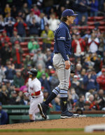 Boston Red Sox's Michael Chavis, back left, runs the bases after hitting a home run off a pitch by Tampa Bay Rays' Tyler Glasnow, right, during the seventh inning of a baseball game at Fenway Park, Sunday, April 28, 2019, in Boston. (AP Photo/Steven Senne)